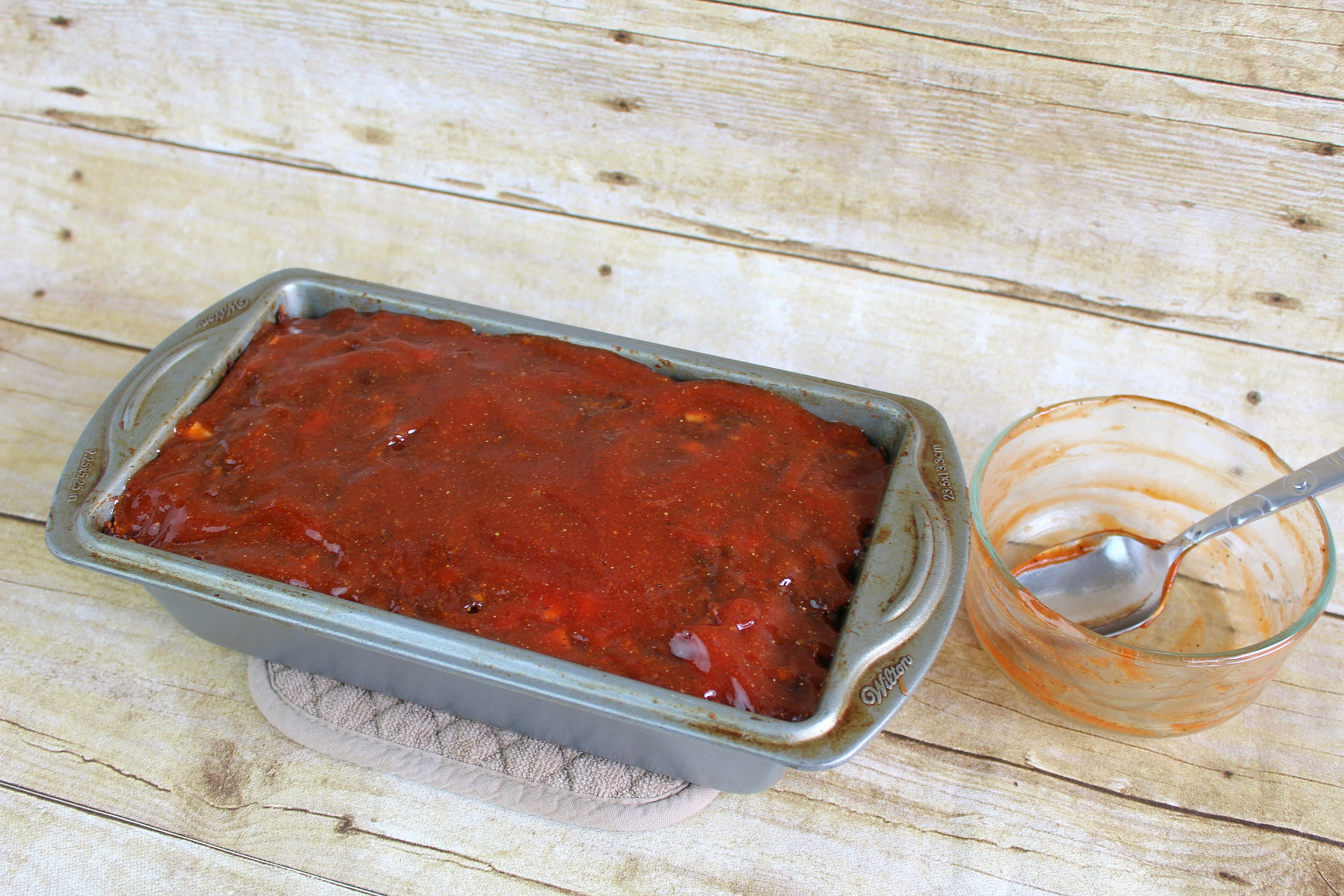 Apply sauce to the top of the meatloaf after it's cooked for about and hour