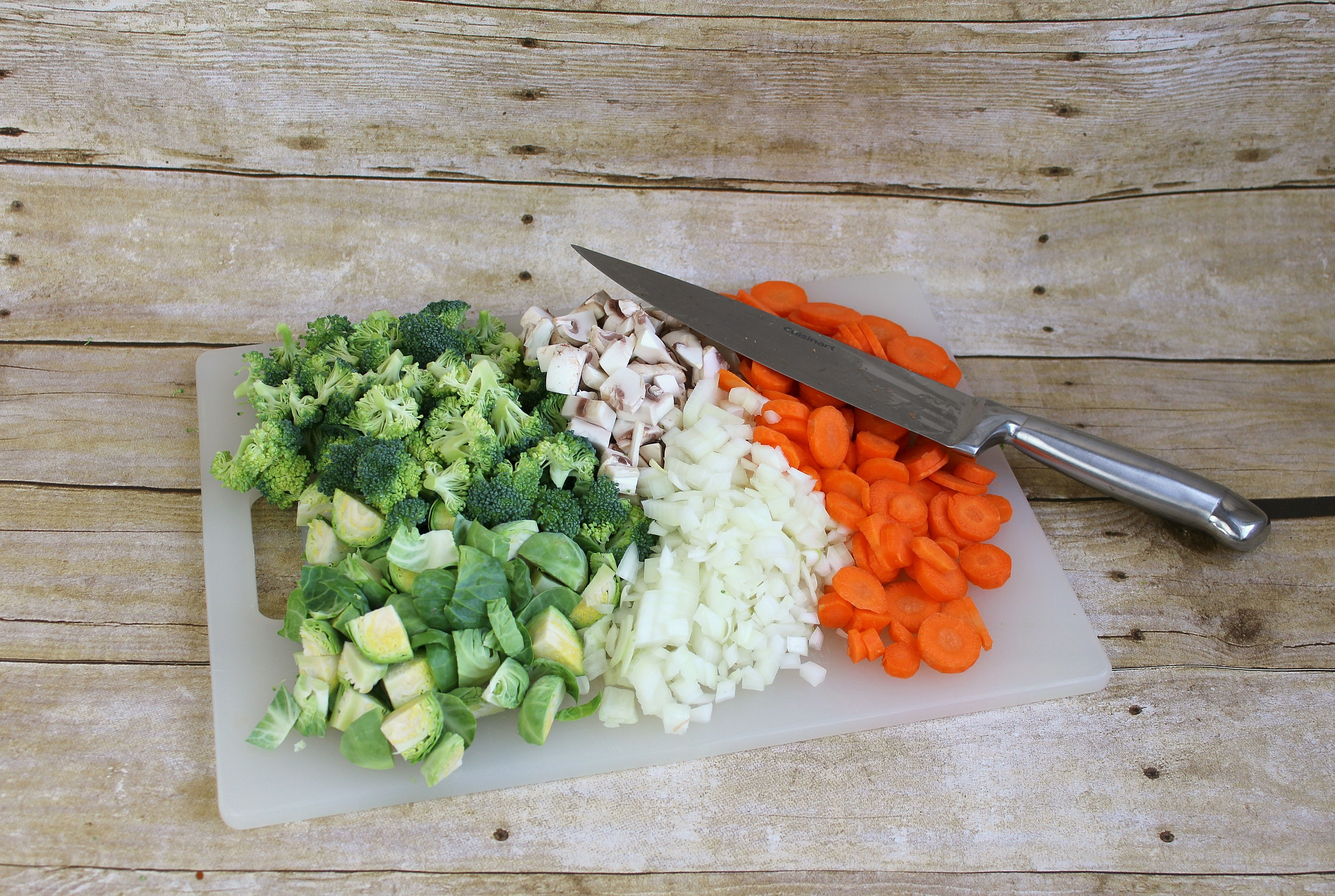 Chop broccoli, onions, carrots, and mushrooms and set aside