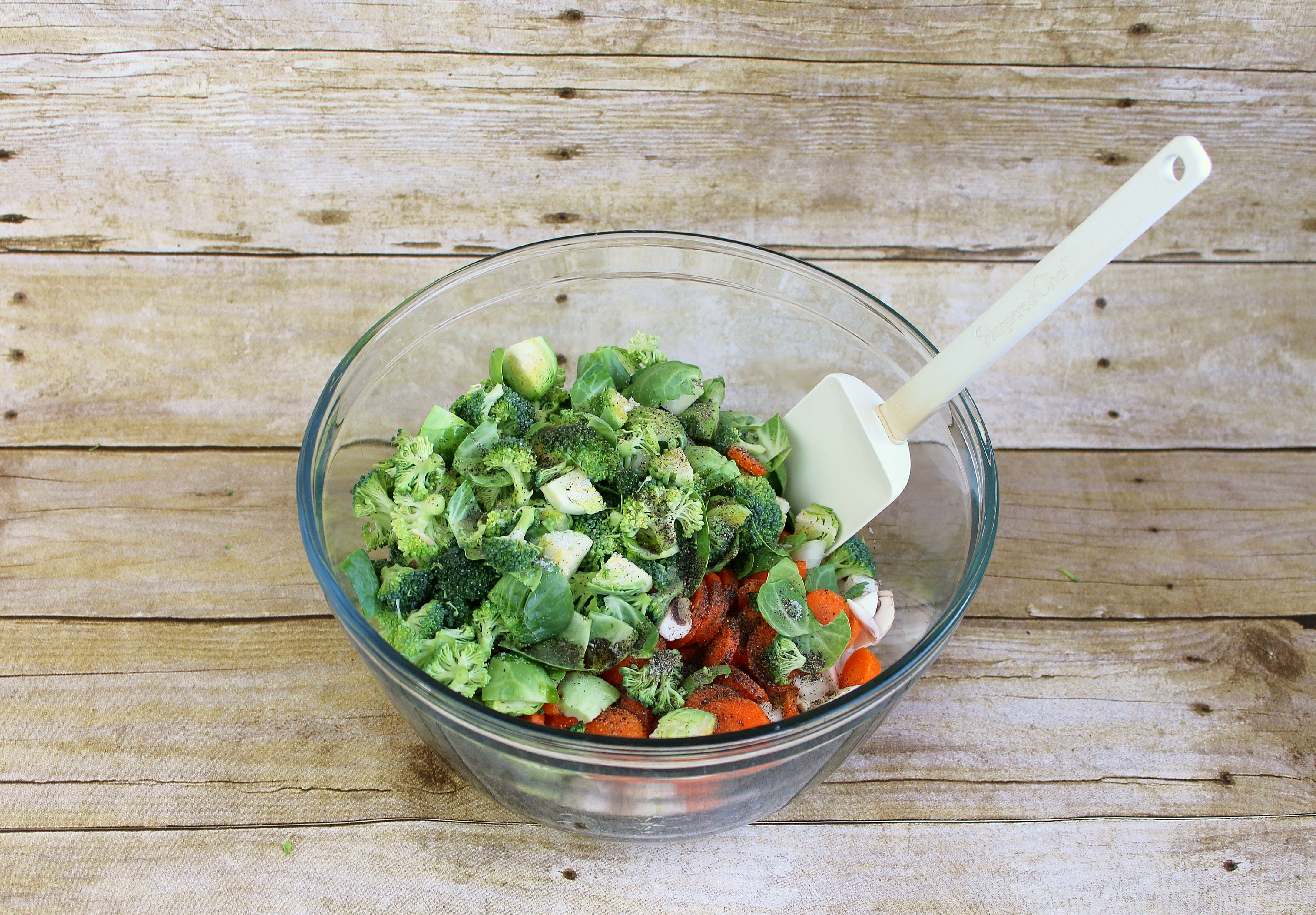Mix chopped veggies with olive oil