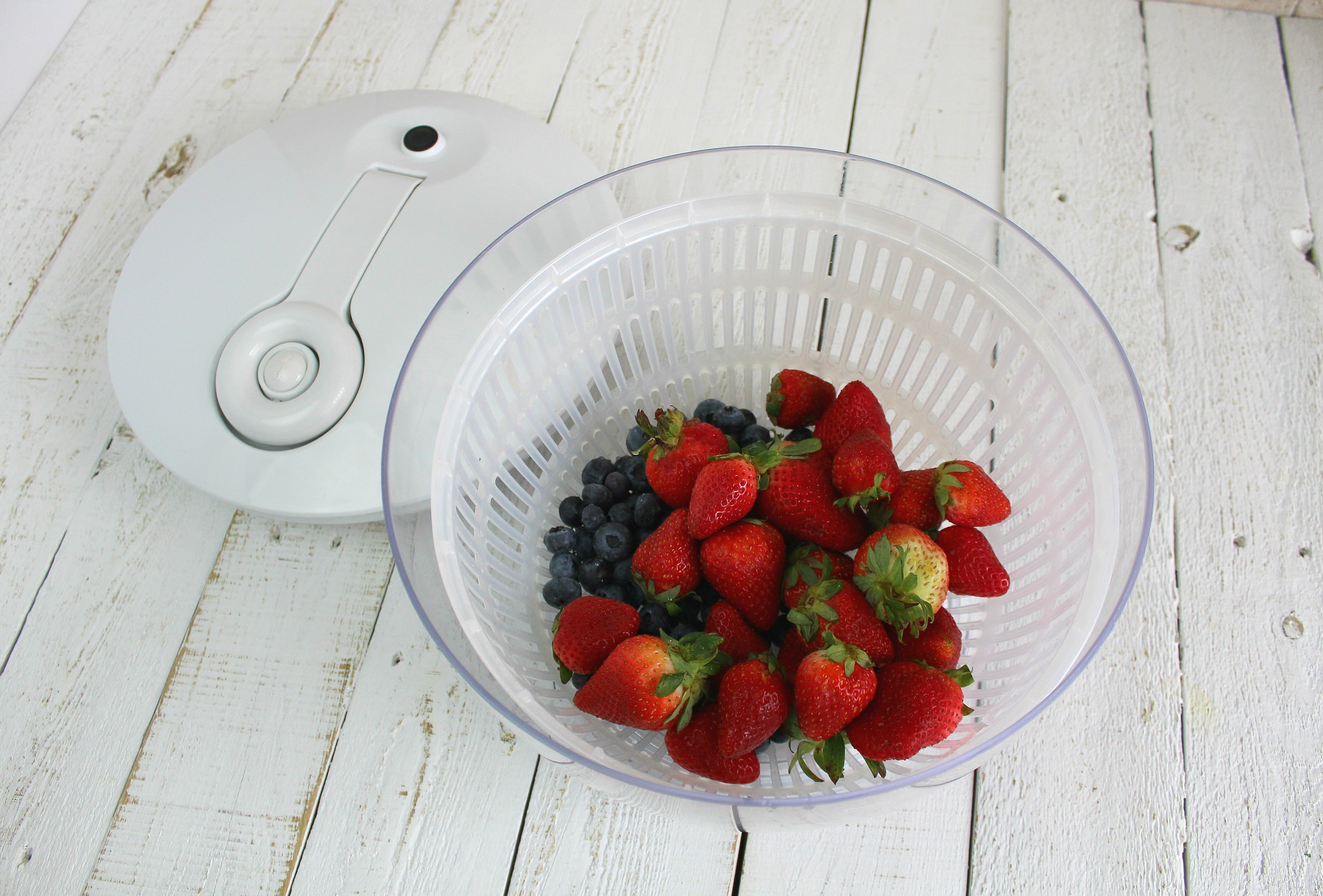 Wash berries in a bowl