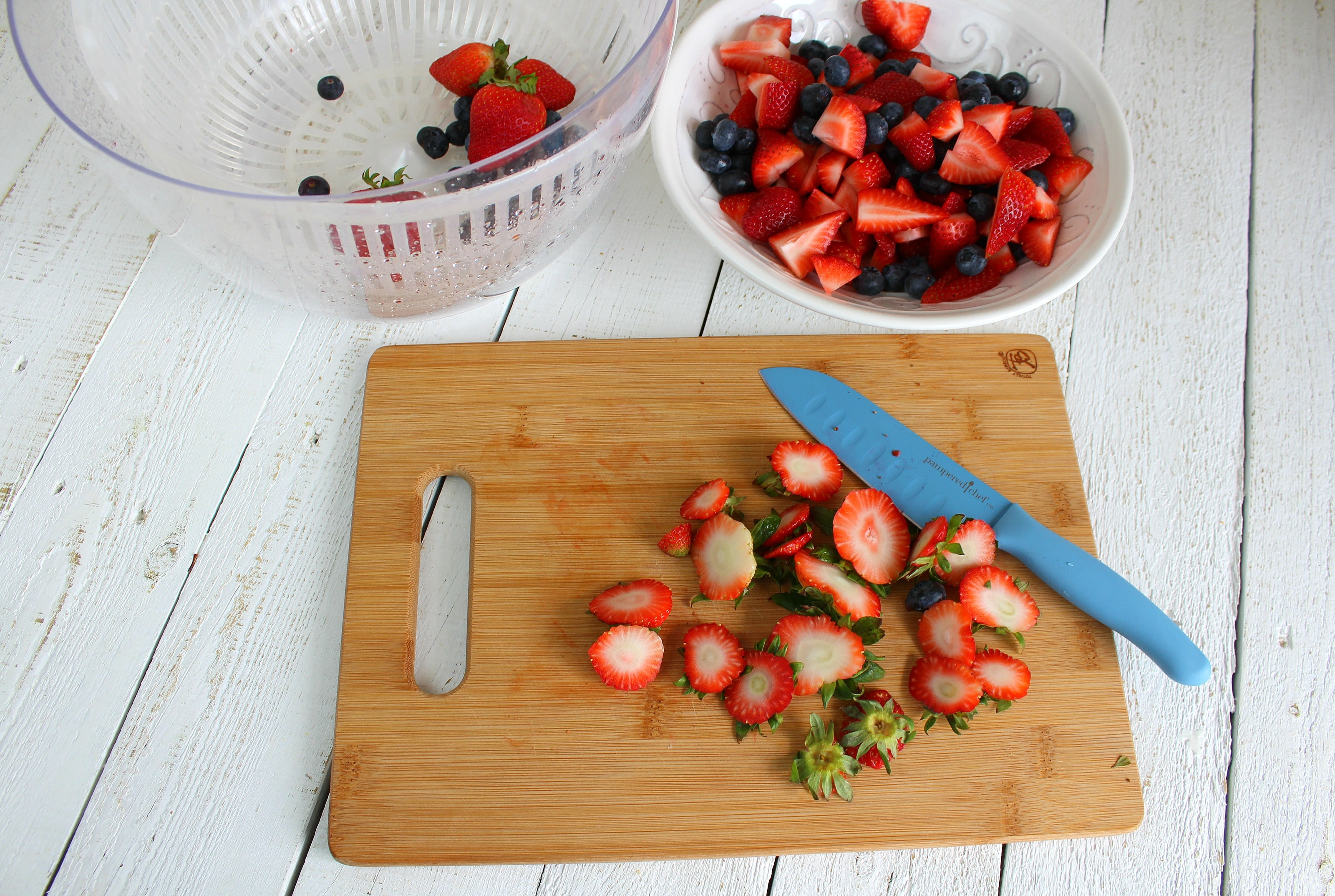 Cup tops off strawberries and chop strawberries into smaller pieces