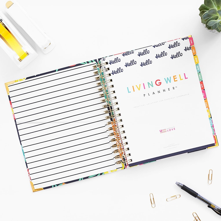 Planner® features pretty florals, stripes, and navy accents.