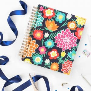 Our fresh new Living Well Planner® is now available for preorder, and we can't WAIT to share it with you! In fact, we are pretty sure our latest edition is going to knock your socks off! Keep reading to find out more about what the next generation of the life-changing Living Well Planner® will include, how you can get your hands on one, and how you can take advantage of our lowest price of the entire year (plus get 2 AWESOME free gifts with your purchase!)