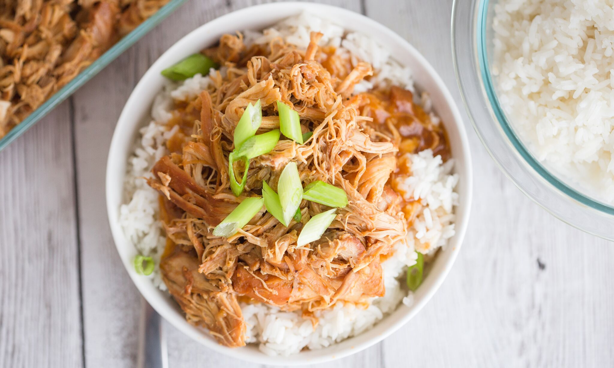 Serve cooked chicken over rice topped with green onions.