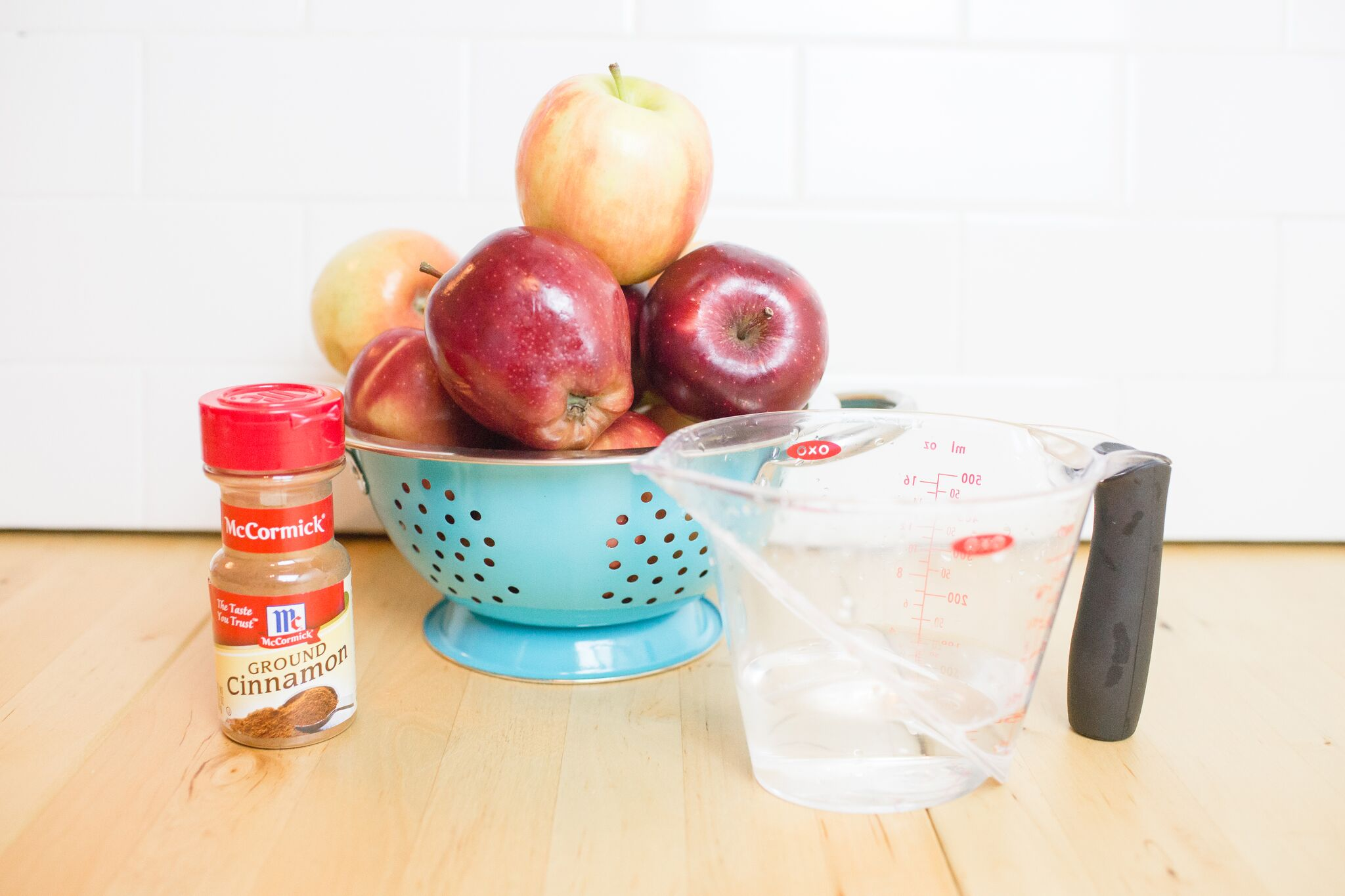 Assemble your ingredients for your Instant Pot applesauce: apples and cinnamon.