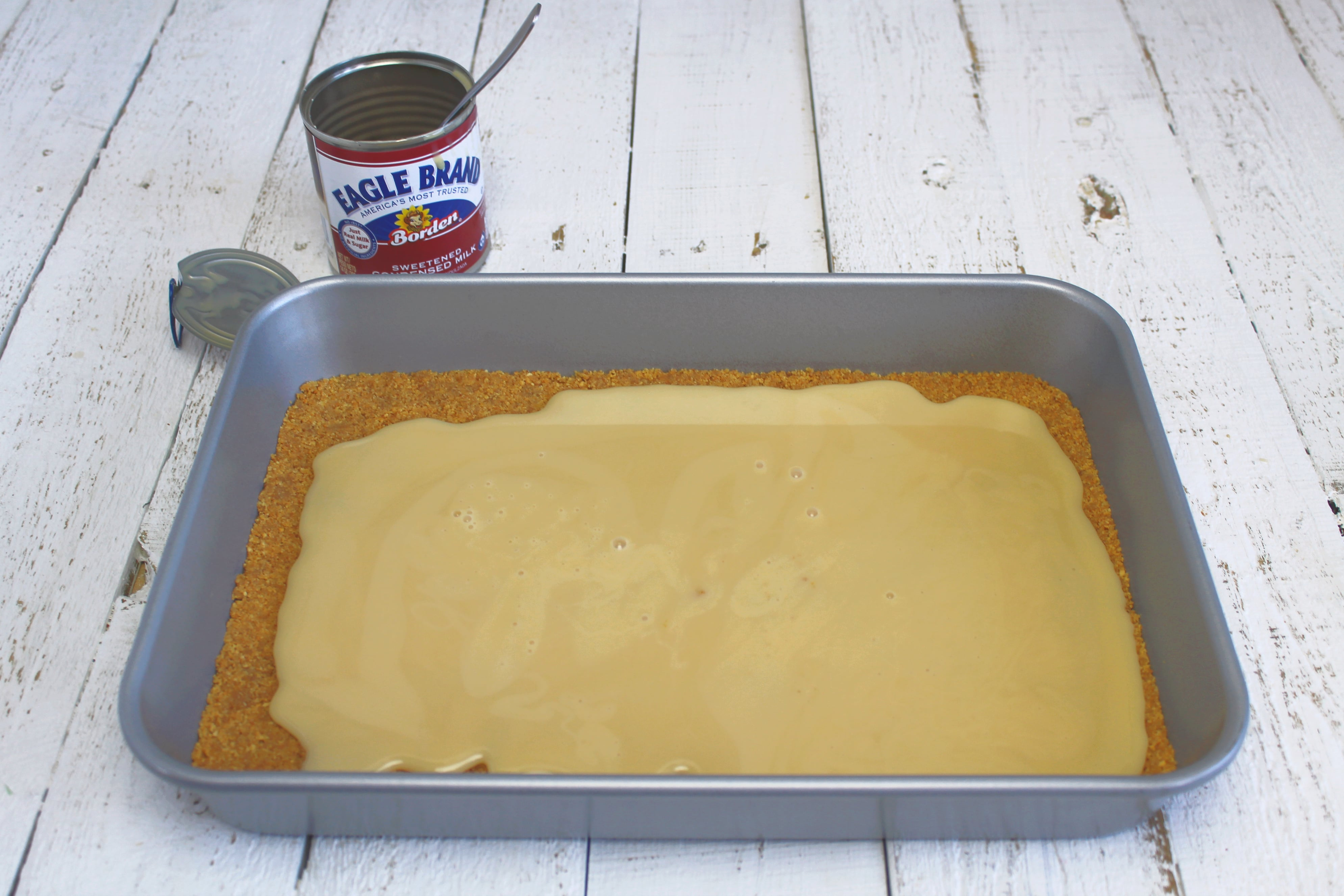 Drizzle sweetened condensed milk evenly over crust.