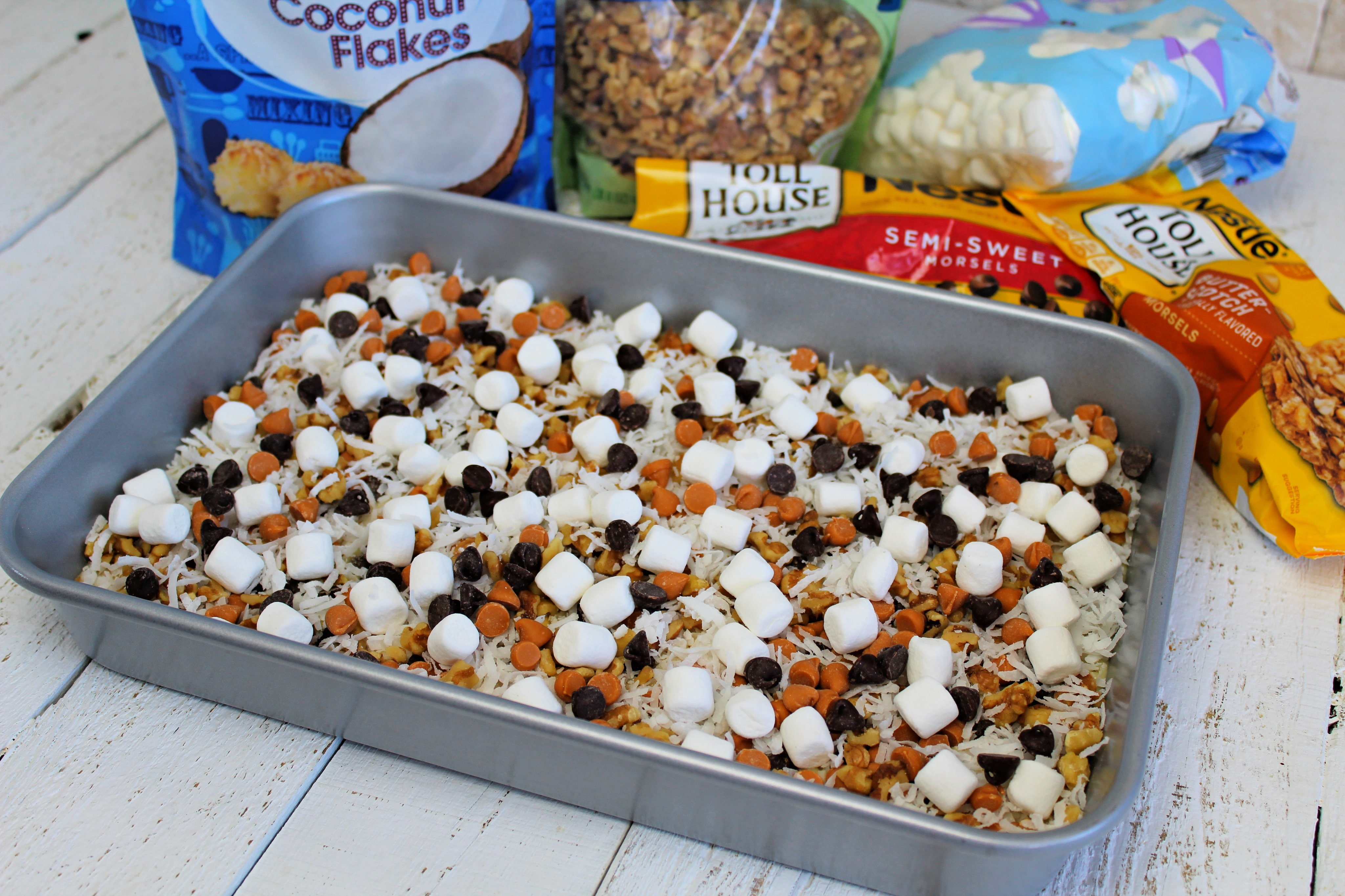 Sprinkle coconut, marshmallows, chocolate chips and butterscotch chips over crust.