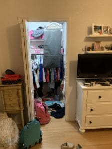 Before Maggie & Annie's closet.Ever feel like your mess has gotten to the point of no return? It might be time to get some help with all that decluttering! Don't miss these three surprising lessons from hiring a professional organizer. Decluttering | Organizing | Hiring a Professional Organizer | Marie Kondo