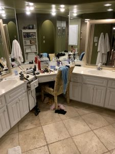 Ruth's bathroom before-Ever feel like your mess has gotten to the point of no return? It might be time to get some help with all that decluttering! Don't miss these three surprising lessons from hiring a professional organizer. Decluttering | Organizing | Hiring a Professional Organizer | Marie Kondo