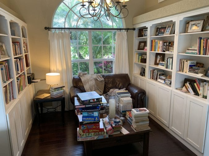 The before picture of the library. Ever feel like your mess has gotten to the point of no return? It might be time to get some help with all that decluttering! Don't miss these three surprising lessons from hiring a professional organizer. Decluttering | Organizing | Hiring a Professional Organizer | Marie Kondo