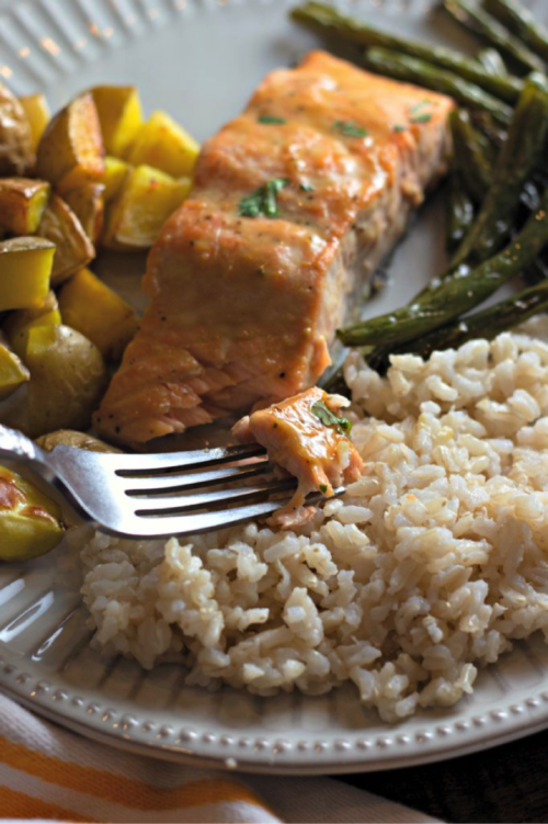 Serve with brown rice if you life. Such a great light meal for any night of the week. Looking for a quick dinner recipe that uses just 5 ingredients? This Maple Glazed Sheet Pan Salmon with Potatoes and Green Beans is so easy and delicious! #recipes #easyrecipes #seafoodrecipes #onepanrecipes #5ingredientrecipes