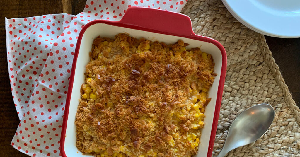 It's hard to find a side dish that even the pickiest eaters will embrace, but this Creamy Corn Casserole with crushed Ritz Cracker topping definitely does the trick. It's easy, delicious and always a hit--your new holiday go-to recipe! #recipes #cornrecipes #casserolerecipes #kidfriendlyrecipes #easyrecipes #holidayrecipes