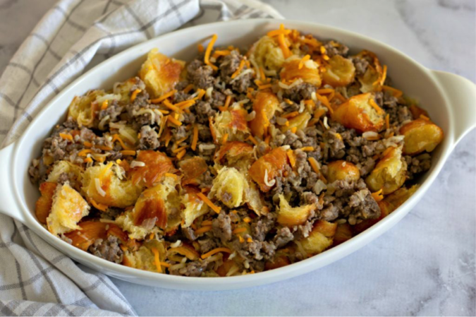 Place sausage, cheese and bread in casserole dish.